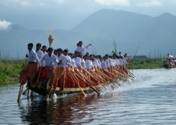 rowing boat with one leg in inle